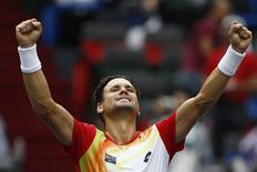 David Ferrer of Spain celebrates winning his men's singles tennis match against Andy Murray of Britain at the Shanghai Masters tennis tournament in Shanghai October 9, 2014. REUTERS/Aly Song