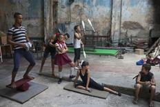 Children practise at a circus school during a training session in Havana, September 26, 2014. REUTERS/Alexandre Meneghini