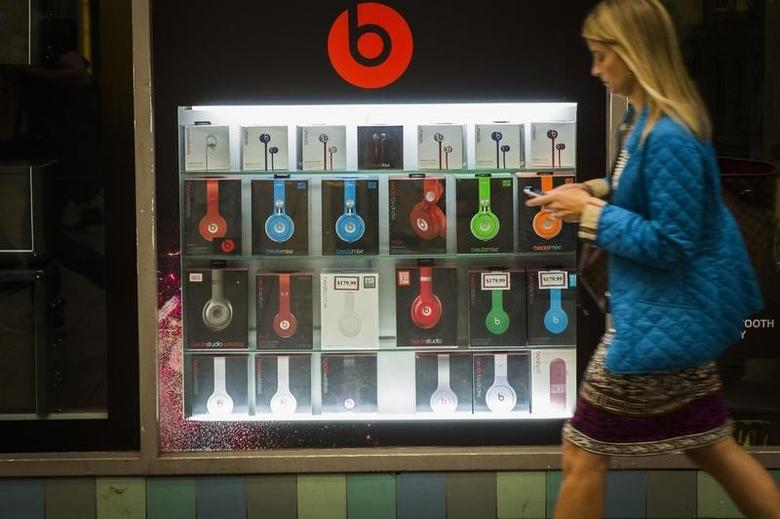 A pedestrian walks past a Beats brand display in the subway system of New York, May 29, 2014. REUTERS/Lucas Jackson