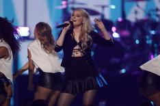 Meghan Trainor (C) performs during the 2014 iHeartRadio Music Festival in Las Vegas, Nevada September 20, 2014.  REUTERS/Steve Marcus