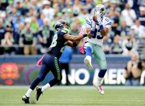 Oct 12, 2014; Seattle, WA, USA; Dallas Cowboys wide receiver Terrance Williams (83) catches a pass over Seattle Seahawks defensive back Marcus Burley (28) during the second half at CenturyLink Field. Dallas defeated Seattle 30-23. Mandatory Credit: Steven Bisig-USA TODAY Sports