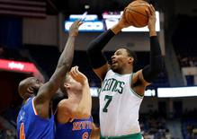 Oct 8, 2014; Hartford, CT, USA; Boston Celtics center Jared Sullinger (7) shoots against New York Knicks forward Travis Wear (6) and forward Quincy Acy (4) in the second half at XL Center. The Celtics defeated the New York Knicks 106-86. Mandatory Credit: David Butler II-USA TODAY Sports