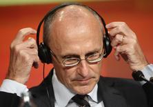 European Banking Authority (EBA) chairman Andrea Enria adjusts his headphone during the annual regulatory conference of Austrian markets watchdog FMA in Vienna September 30, 2014.  REUTERS/Heinz-Peter Bader