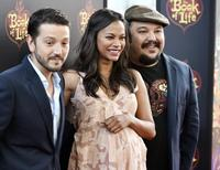 "Cast members Diego Luna (L), Zoe Saldana (C) and director Jorge R. Gutierrez pose during the premiere of the film ""Book of Life"" in Los Angeles, California October 12, 2014. REUTERS/Kevork Djansezian"