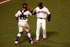Oct 15, 2014; San Francisco, CA, USA; San Francisco Giants relief pitcher Santiago Casilla (46) celebrates with catcher Buster Posey (28) after beating the St. Louis Cardinals in game four of the 2014 NLCS playoff baseball game at AT&T Park. Mandatory Credit: Kelley L Cox-USA TODAY Sports