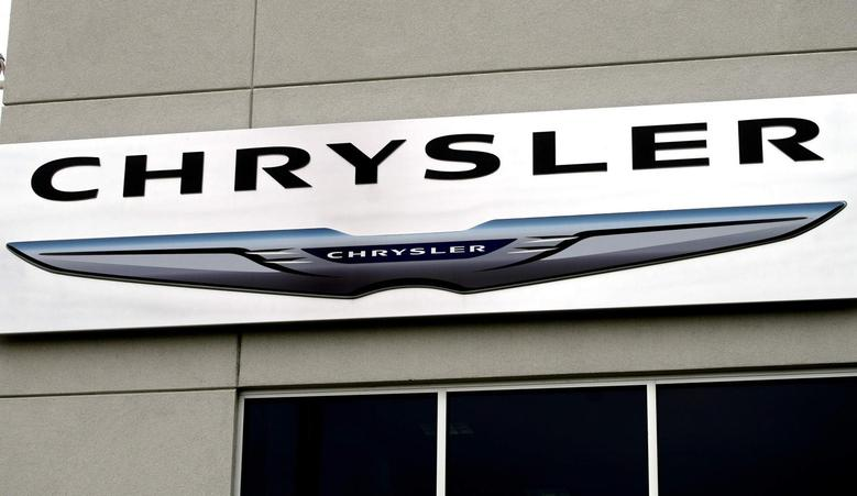The Chrysler logo is seen outside the Chrysler auto dealer in Broomfield, Colorado October 1, 2014.  REUTERS/Rick Wilking