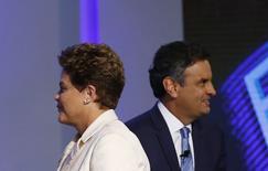 Presidente Dilma Rousseff, candidata do PT à reeleição, e candidato Aécio Neves (PSDB) durante debate em emissora de TV no Rio de Janeiro.  2/10/2014 REUTERS/Ricardo Moraes