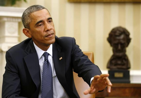 U.S. President Barack Obama answers a question from the press after meeting with his team coordinating the government's Ebola response in the Oval Office of the White House in Washington, October 16, 2014.  REUTERS/Larry Downing