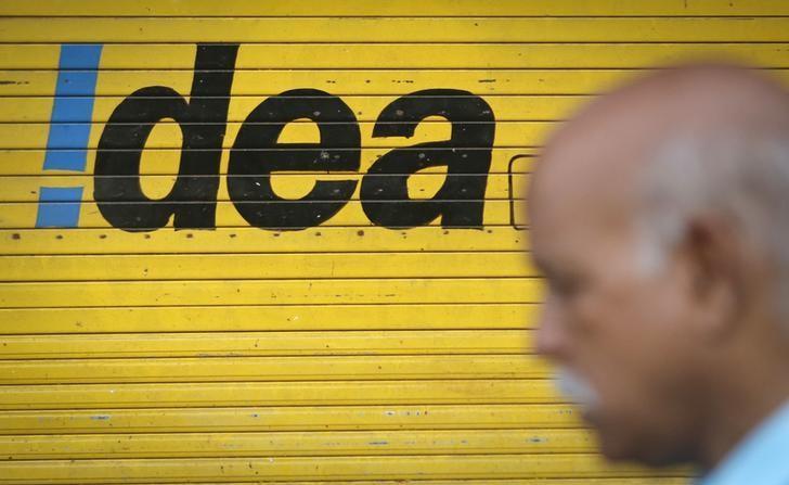 A man walks past a shop displaying Idea Cellular Ltd's logo on its shutters in Mumbai April 28, 2014. REUTERS/Danish Siddiqui/Files