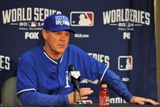 Kansas City Royals manager Ned Yost (3) talks with members of the media during a press conference the day before the start of the 2014 World Series at Kauffman Stadium. Christopher Hanewinckel-USA TODAY Sports