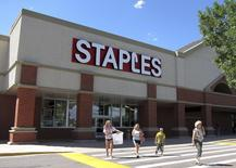 A family leaves the Staples store in Broomfield, Colorado August 17, 2011. REUTERS/Rick Wilking