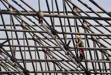 L'économie chinoise a crû de 7,3% au troisième trimestre 2014, son rythme le plus faible depuis près de six ans, nouvelle illustration du ralentissement progressif de la deuxième économie mondiale. /Photo prise le 12 octobre 2014/REUTERS