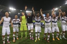 Jogadores do Bayern de Munique comemoram goleada sobre a Roma.  REUTERS/Alessandro Bianchi