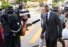 Oct 8, 2014; Conroe, TX, USA; Minnesota Vikings running back Adrian Peterson enters the Montgomery county courthouse for his arraignment. Mandatory Credit: Kevin Jairaj-USA TODAY Sports