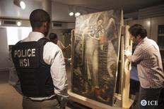Homeland Security agents prepare to pack a stolen colonial-era painting being returned to the government of Peru in this undated handout photo provided by Homeland Security in San Antonio Texas, October 22, 2104.  REUTERS/Homeland Security/Handout via Reuters