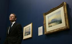 "Nicholas Serota, Director of Tate, speaks at a news conference on Turner's ""The Blue Rigi"" (R), in London March 1, 2007. REUTERS/Luke MacGregor"