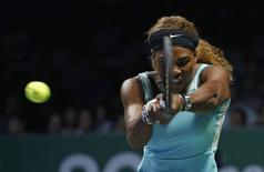 Serena Williams of the U.S. hits a return to Eugenie Bouchard of Canada during their WTA Finals singles tennis match at the Singapore Indoor Stadium October 23, 2014. REUTERS/Edgar Su