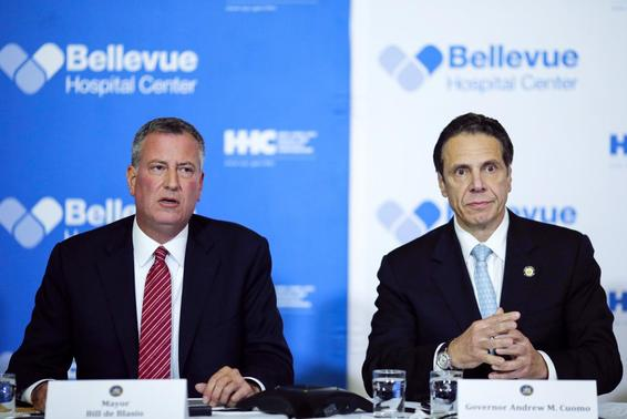New York Mayor Bill de Blasio (L) and New York Governor Andrew Cuomo attend a news conference in Bellevue Hospital in New York October 23, 2014. REUTERS/Eduardo Munoz