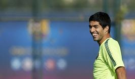 Barcelona's players Luis Suarez smiles during a training session at Joan Gamper training camp, near Barcelona October 20, 2014. FC Barcelona and Ajax will play their Champions league soccer match on Tuesday. REUTERS/Albert Gea (SPAIN - Tags: SPORT SOCCER)