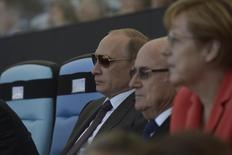 Russian President Vladimir Putin (L), German Chancellor Angela Merkel (R) and FIFA President Sepp Blatter watch the 2014 World Cup final between Germany and Argentina at the Maracana stadium in Rio de Janeiro July 13, 2014. REUTERS/Alexey Nikolsky/RIA Novosti/Kremlin (BRAZIL - Tags: SPORT SOCCER WORLD CUP POLITICS) ATTENTION EDITORS - FOR EDITORIAL USE ONLY. NOT FOR SALE FOR MARKETING OR ADVERTISING CAMPAIGNS. THIS IMAGE HAS BEEN SUPPLIED BY A THIRD PARTY. IT IS DISTRIBUTED, EXACTLY AS RECEIVED BY REUTERS, AS A SERVICE TO CLIENTS