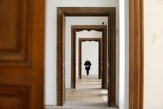 A worker puts the final touch during the renovation of the Hotel Sale known as the Picasso Museum in the Marais district of Paris, March 4, 2014. REUTERS/Charles Platiau