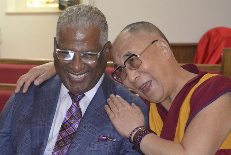 The Dalai Lama, spiritual leader of Tibet, talks with Birmingham mayor William Bell during an interview at the 16th Street Baptist Church in Birmingham, Alabama October 25, 2014.  REUTERS/Sherrel Wheeler Stewart