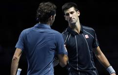 Novak Djokovic of Serbia shakes hands with Roger Federer of Switzerland following their men's singles tennis match at the ATP World Tour Finals at the O2 Arena in London November 5, 2013.  REUTERS/Suzanne Plunkett