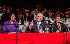 Toronto mayoral candidates Olivia Chow (L), Doug Ford (C) and John Tory pose with school children after a municipal debate for the upcoming city election in Toronto in this September 23, 2014 file photo. REUTERS/Mark Blinch/Files