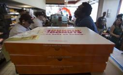 Boxes of donuts ready for pick up are pictured at a newly opened Dunkin' Donuts store in Santa Monica, California September 2, 2014. REUTERS/Mario Anzuoni