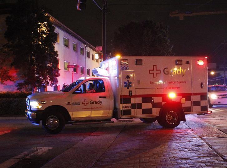 An ambulance transporting Amber Joy Vinson arrives at Emory University Hospital in Atlanta, Georgia October 15, 2014. REUTERS/Tami Chappell