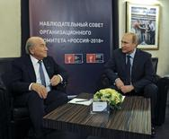 FIFA President Sepp Blatter (L) talks with Russia's President Vladimir Putin during a meeting in Moscow, October 28, 2014. REUTERS/Mikhail Klimentyev/RIA Novosti/Kremlin