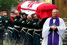 Soldiers carry the casket from the church following the funeral service for Cpl. Nathan Cirillo in Hamilton, Ontario October 28, 2014. REUTERS/Mark Blinch