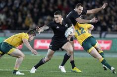 Sonny Bill Williams of New Zealand's All Blacks looks to fend off Michael Hooper (L) of Australia's Wallabies' in their Bledisloe Cup rugby union test match in Auckland August 25, 2012.  REUTERS/Nigel Marple