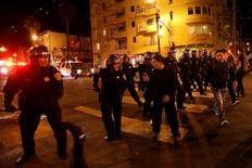 Police officers disperse a crowd in the Mission District, in San Francisco, California October 29, 2014. REUTERS/Stephen Lam