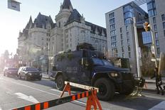 A Royal Canadian Mounted Police vehicle passes the Fairmont Chateau Laurier as it leaves a secure area downtown following shootings in Ottawa October 22, 2014. REUTERS/Blair Gable