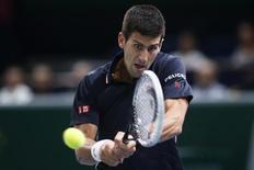 Novak Djokovic of Serbia returns a shot during his men's singles semi-final tennis match against Kei Nishikori of Japan at the Paris Masters tennis tournament at the Bercy sports hall in Paris, November 1, 2014. REUTERS/Benoit Tessier