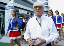 Formula One commercial supremo Bernie Ecclestone arrives for the drivers' parade before the first Russian Grand Prix in Sochi October 12, 2014. REUTERS/Laszlo Balogh