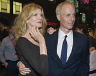 "Cast member Rene Russo arrives with her husband and film's director Dan Gilroy for the premiere of the film ""Nightcrawlers"" at the Toronto International Film Festival in Toronto, September 5, 2014. REUTERS/Fred Thornhill"