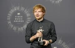 "Singer Ed Sheeran poses backstage after winning the award for best male video for ""Sing"" during the 2014 MTV Video Music Awards in Inglewood, California August 24, 2014.   REUTERS/Kevork Djansezian"