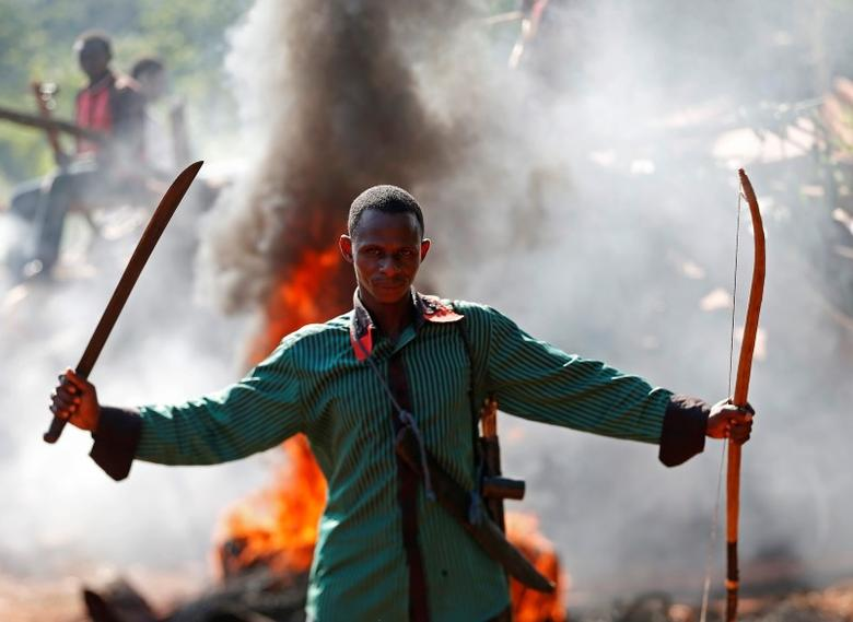 A man gestures in front of a burning barricade during a protest against French soldiers in Bambari May 22, 2014. REUTERS/Goran Tomasevic