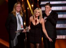 "Singer Miranda Lambert accepts the Album of the Year Award for ""Platinum"" with her producers Chuck Ainlay (L) and Frank Liddell during the 48th Country Music Association Awards in Nashville, Tennessee November 5, 2014.  REUTERS/Harrison McClary"
