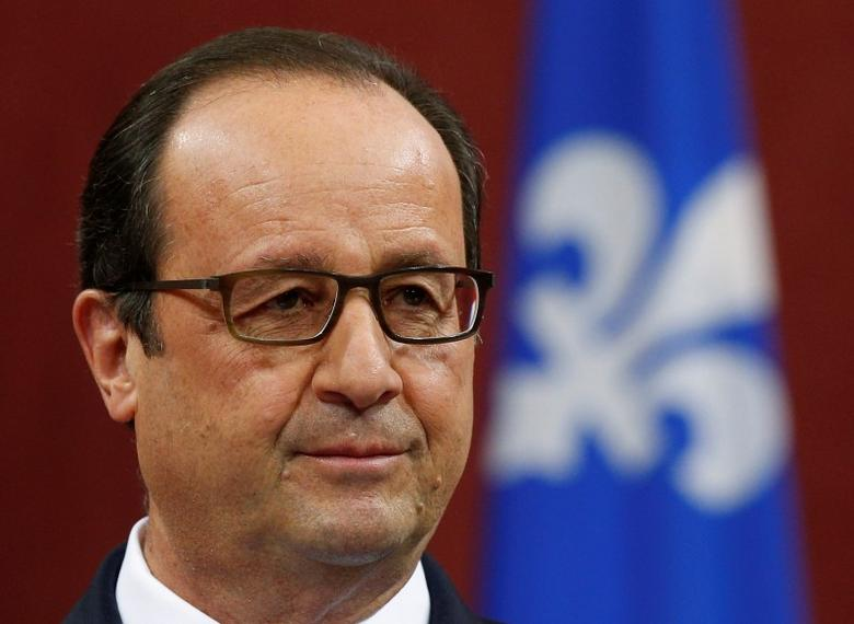 French President Francois Hollande listens to a question during a news conference at the National Assembly in Quebec City, November 4, 2014. REUTERS/Mathieu Belanger