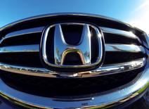 The front grill of a Honda truck is shown on car lot in Carlsbad, California November 5, 2014.  REUTERS/Mike Blake