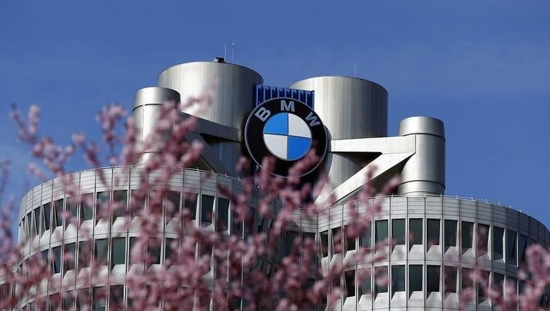 Trees bloom in front of the headquarters of German luxury car maker BMW in Munich March 18, 2014. REUTERS/Michael Dalder