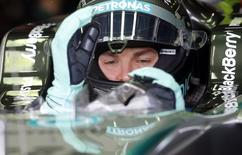 Mercedes Formula One driver Nico Rosberg of Germany sits in his car ahead the first practice session of the Brazilian Grand Prix in Sao Paulo November 7, 2014. The Brazilian Grand Prix will be held on Sunday. REUTERS/Paulo Whitaker (BRAZIL - Tags: SPORT MOTORSPORT F1)