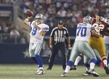 Dallas Cowboys quarterback Tony Romo (9) throws in the pocket against the Washington Redskins at AT&T Stadium. Mandatory Credit: Matthew Emmons-USA TODAY Sports