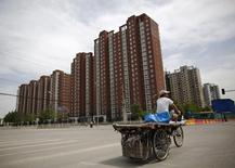 A garbage collector rides his tricycle as he looks for recyclable items on the streets of Beijing May 26, 2014. REUTERS/Kim Kyung-Hoon