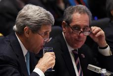 U.S. Secretary of State John Kerry (L) has a drink as U.S. Trade Representative Michael Froman (R) looks on at the start of Asia-Pacific Economic Cooperation (APEC) Summit ministerial meetings at the China National Convention Centre (CNCC) in Beijing, November 7, 2014. REUTERS/Greg Baker/Pool