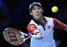 Kei Nishikori of Japan hits a return during his men's singles tennis match against Andy Murray of Britain at the ATP World Tour Finals at the O2 Arena in London November 9, 2014.  REUTERS/Dylan Martinez