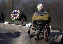 U.S. Marine combat veteran Charlie Wittwer pays his respects at the National Vietnam Veterans Memorial on Veteran's Day in Washington, November 11, 2014.       REUTERS/Larry Downing